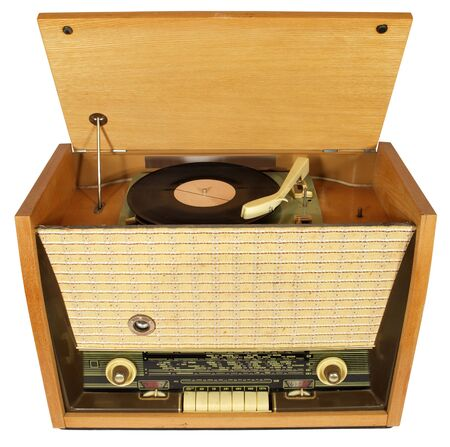 Vintage radio-gramophone with a raised lid and a gramophone record