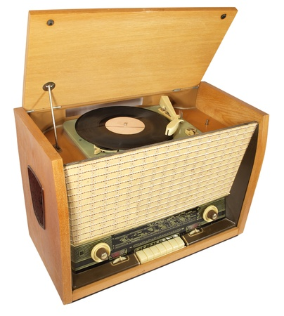 Vintage radio-gramophone with a raised lid and a gramophone record       photo