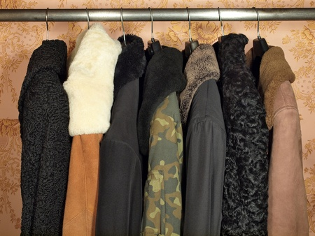 Winter clothes on a hanger in the closet.       photo