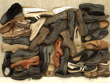 A large number of diverse old shoes