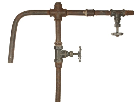 A fragment of the old water conduit consisting of pipes, fittings and valve        Stock Photo - 12195031