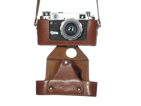 Classic vintage camera in a leather cover, isolated on white background  photo