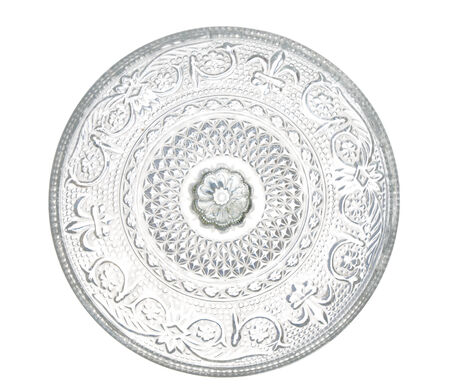 arnamentom: plate made of transparent glass with patterns, isolated on white background.