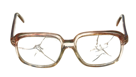 Old broken glasses isolated on white background.