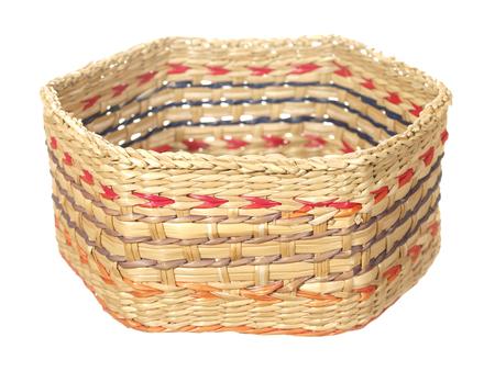 Empty decorative basket of hexagonal shape isolated on white background.