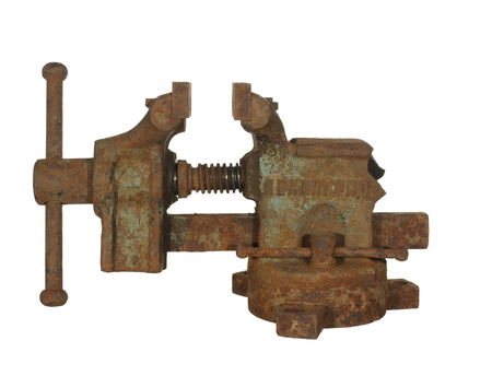 Old rusty metalwork vise made in the USSR, isolated on white background. The inscription LENINGRAD is visible.