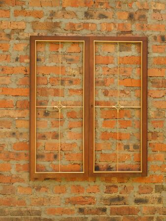 Wooden background with an old brick wall.