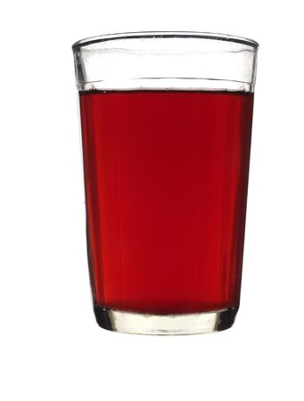 Faceted glass filled with red wine isolated on white background.