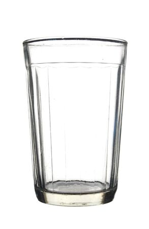 Empty faceted glass isolated on white background.