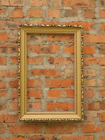 Picture frame from baguette on the background of an old brick wall 版權商用圖片
