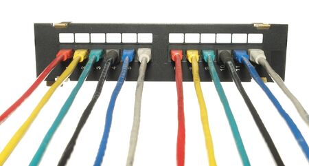 Hub of twelve ports with colorful LAN cables isolated on white background 版權商用圖片