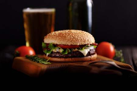 Beef burger ready to eat with beer.