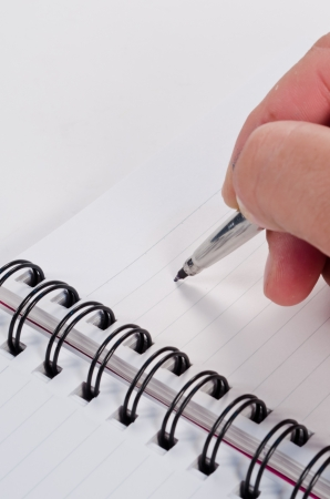 hand writing with pen on notebook Stock Photo - 14215489