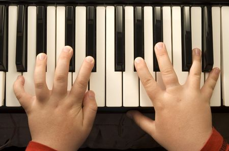 keyboard music: Child playing a Piano Stock Photo