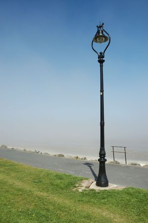 lampost: Lampost on Sandymount strand looking over Dublin Bay, Ireland