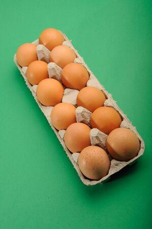 dozen: One Dozen Fresh Eggs in tray Stock Photo