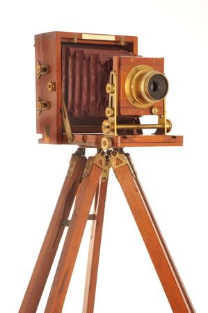 old camera: Very Old Camera on a wooden tripod on a white background Stock Photo