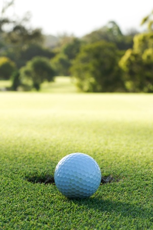 golf green: A golf ball and hole Stock Photo