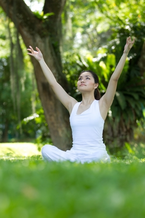 Woman in white Performing yoga in natural setting Stock Photo - 10320642