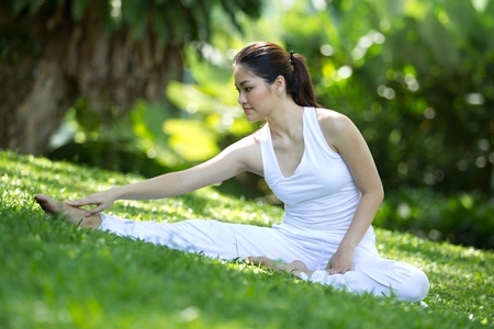 Woman in white Performing yoga in natural setting Stock Photo - 10320641