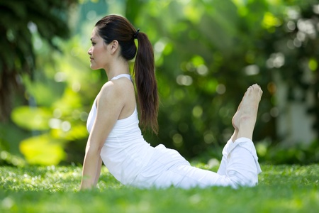 Woman in white Performing yoga in natural setting Stock Photo - 10320643