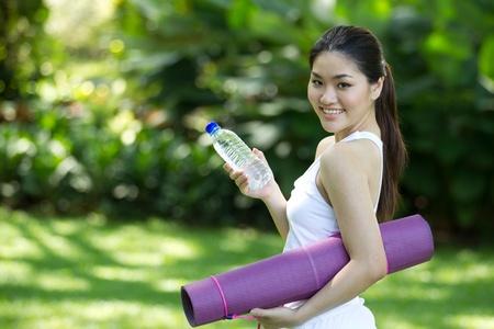 Woman in white ready to perform yoga Stock Photo - 10320644