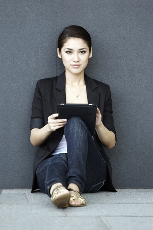 joy pad: Business woman using a touch pad