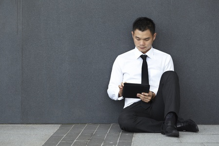 Business man using a touchpad photo