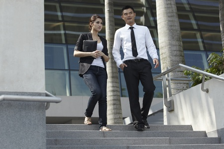 Business couple talking in modern urban setting photo