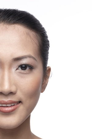 sideways glance: Close-up image of an Asian woman. Isolated on a white background. Stock Photo