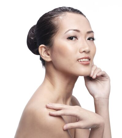 Fresh clear healthy skin on the face of beautiful Asian woman over white background Stock Photo - 10321829