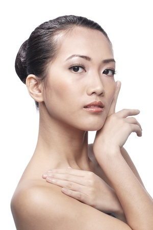 Fresh clear healthy skin on the face of beautiful Asian woman over white background photo