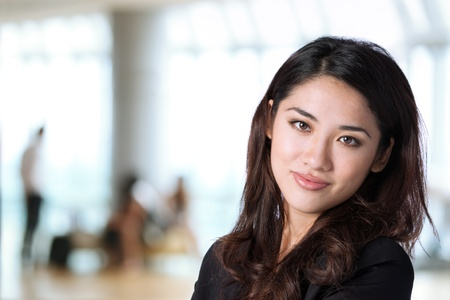 asian office lady: Business woman in corporate setting. The background is out of focus. Stock Photo