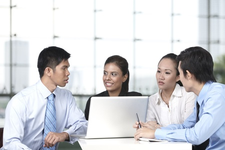 Asian business colleagues working around a laptop Stock Photo - 10322435