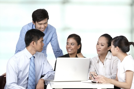 Asian business colleagues working around a laptop Stock Photo - 10322438