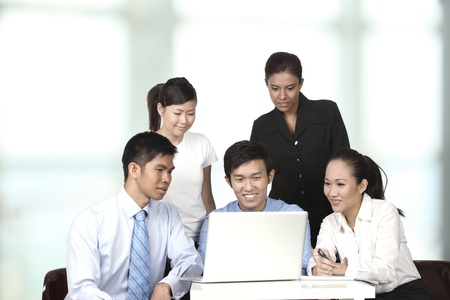 asian office lady: Asian business colleagues working around a laptop