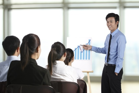 Business man discussing finance chart in meeting room photo