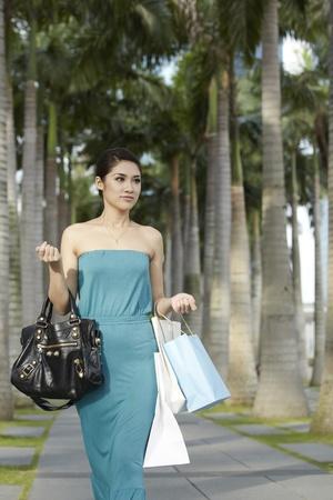 Beautiful Asian woman with shopping bags photo