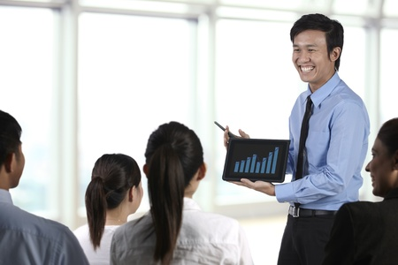Business man discussing finance chart on a touch pad photo