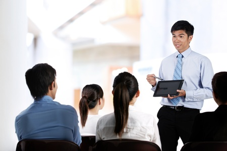 Portrait of a group of Asian businesspeople in meeting photo