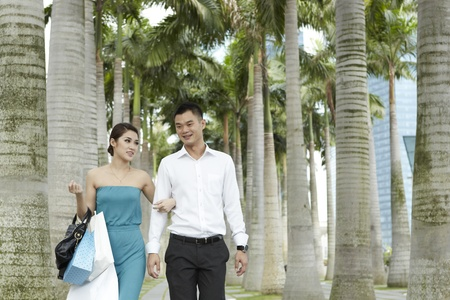 Asian man and woman with shopping bags photo