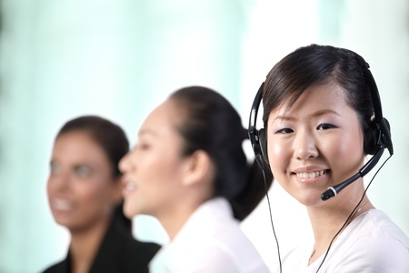 Closeup of a young Asian customer service woman smiling photo