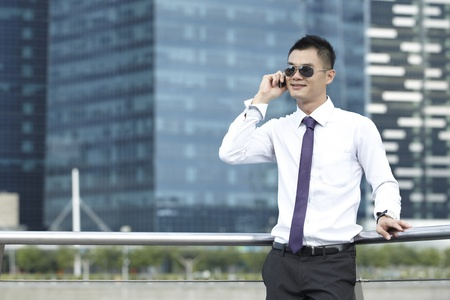 Asian Business man using a Cell Phone Stock Photo - 10322501