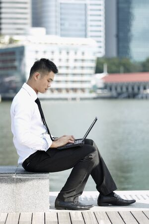 Business man using a touch pad photo