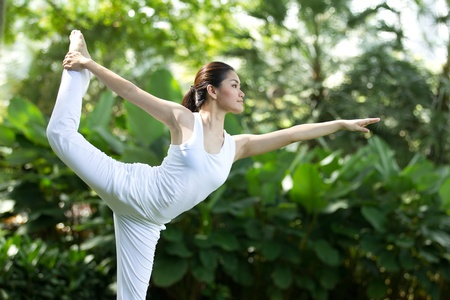 Woman in white Performing yoga in natural setting Stock Photo - 10322479