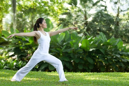 healthy person: Woman in white Performing yoga in natural setting