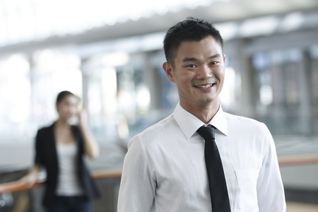 Asian Business man with colleague in background photo