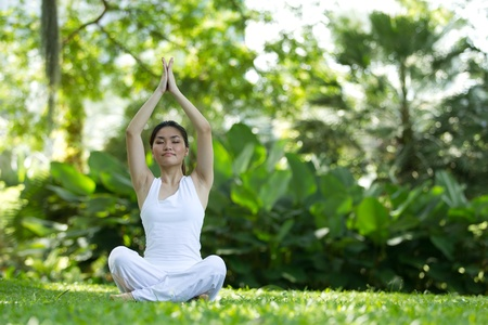 Woman in white Performing yoga in natural setting Stock Photo - 10322483