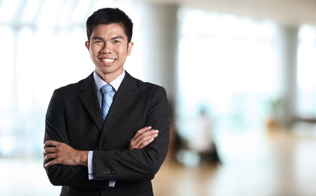Portrait of an Asian Businessman with background out of focus Stock Photo