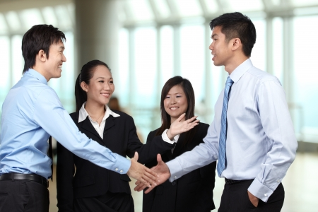 Asian Businessmen shaking hands photo